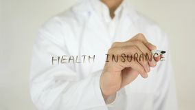 健康保险,写在玻璃 库存照片
