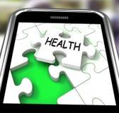 健康智能手机显示医疗健康和自已关心 免版税库存照片