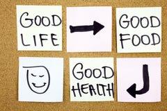 健康生活方式概念-好食物、健康和人生的提示措辞手写稠粘的笔记 库存照片