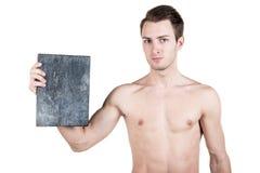 健康生活方式 一个英俊的人的画象有一块空白的牌的写的,当一个赤裸体育机构,被隔绝在白色ba 免版税库存照片