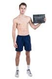 健康生活方式 一个英俊的人的画象有一块空白的牌的写的,当一个赤裸体育机构,被隔绝在白色ba 库存照片