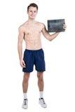 健康生活方式 一个英俊的人的画象有一块空白的牌的写的,当一个赤裸体育机构,被隔绝在白色ba 免版税图库摄影