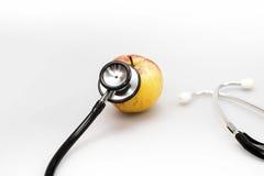 健康苹果概念性饮食吃的医疗保健说明图象营养听诊器 免版税图库摄影