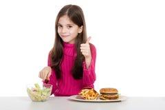 健康食物的女孩一点 免版税库存照片
