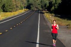 健身四十名妇女赛跑 免版税图库摄影