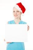 健身圣诞老人妇女拿着空白符号 免版税库存图片