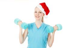健身圣诞老人妇女 免版税库存图片