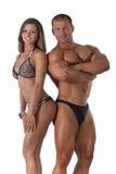年轻健身夫妇画象  免版税图库摄影