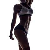 年轻健身妇女剪影  免版税图库摄影