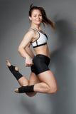 健身妇女跳喜悦 免版税库存照片
