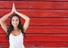 健身妇女,瑜伽有红色木背景 免版税图库摄影