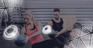 健身房的运动适合人民与三角连接 图库摄影