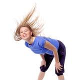 健身有氧运动结合与被弄乱的头发的舞蹈辅导员 库存照片