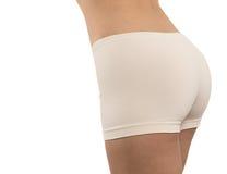 健身短裤的性感的妇女 免版税库存图片