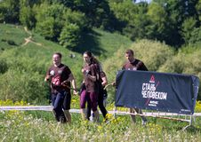 健身节日关于Reebok的在莫斯科公园 赛跑者关闭在节日 体育生活方式 免版税图库摄影