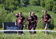 健身节日关于Reebok的在莫斯科公园 赛跑者关闭在节日 体育生活方式 库存照片