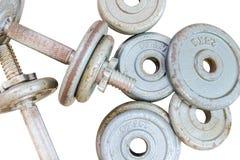 健身设备在背景孤立的哑铃重量 库存图片