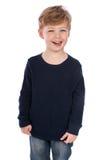 偶然布料的微笑的男孩。 免版税库存图片