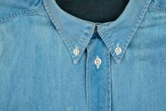偶然衬衣衣领特写镜头在蓝色的 图库摄影