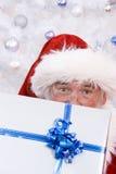 偷看的圣诞老人 免版税库存图片