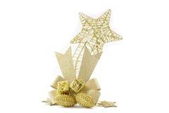 储蓄照片:金黄圣诞节中看不中用的物品的汇集 免版税库存图片