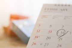储蓄照片:2月 排进日程页与明显日期第14  免版税库存图片