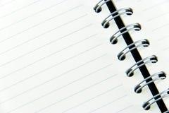 储蓄照片-笔记本白皮书  免版税库存图片