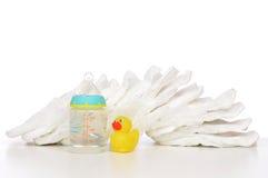 婴儿堆尿布乳头soother婴孩哺养 库存图片