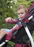 婴儿推车的孩子 免版税库存照片