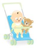 婴儿推车的男婴有玩具熊的 免版税库存图片