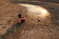 儿童危机水年轻人 库存图片