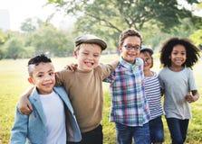 儿童友谊统一性嬉戏的幸福概念 图库摄影