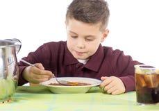 儿童吃16 免版税库存照片