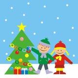 儿童和圣诞树 免版税库存图片