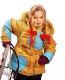 儿童在白色的藏品雪橇。 图库摄影
