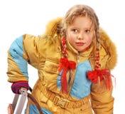 儿童在白色的藏品雪橇。 库存照片