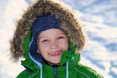 儿童外套微笑的冬天 库存照片