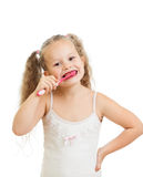 儿童女孩在白色查出的清洁牙 库存照片
