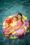 儿童女孩游泳池 图库摄影