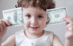 儿童女孩银行货币美元财务系统断裂失业危机 库存照片
