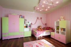 儿童居室内部的现代设计在淡色的 苗圃 免版税库存照片