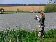 儿童捕鱼 库存照片