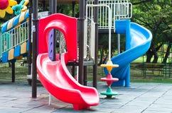 儿童操场在公园 免版税库存图片