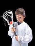 儿童曲棍网兜球球员 免版税库存照片