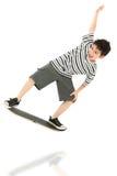 儿童比赛球员滑板录影 库存照片