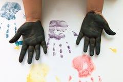 儿童游戏的五颜六色的手和手指 免版税库存图片