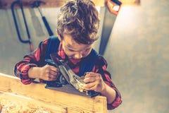 儿童父亲节概念,木匠工具,家 图库摄影