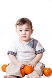 儿童现有量他小的桔子 免版税库存图片