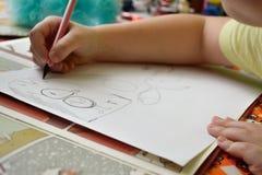 儿童画的` s爱好 免版税库存照片