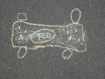 儿童的在沥青的粉笔画 免版税库存照片